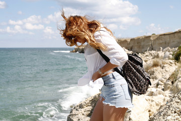 Attractive hipster girl with back pack enjoying her holidays