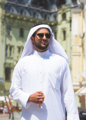 Street portrait of a handsome arabian man