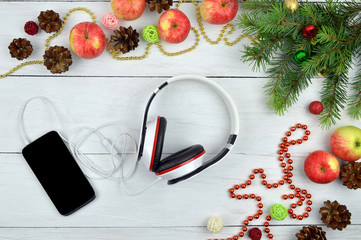 Smartphone and headphone  with rustic Christmas decorations. Chr