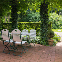 beautiful place in the beergarden with white furniture
