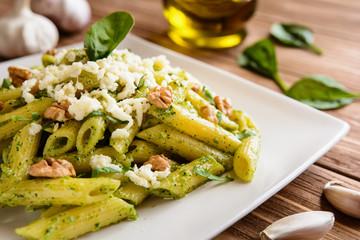 Penne pasta with spinach pesto, walnuts and mozzarella