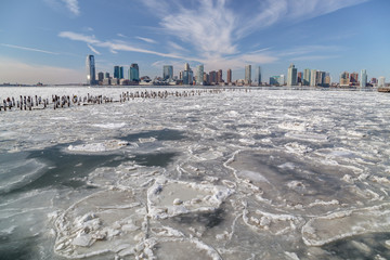 View from Manhattan New York City to Jersey City across the frozen Hudson river in winter. February 2015