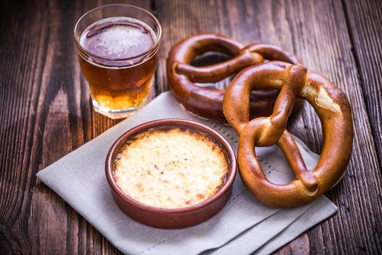 Hot cheese fondue with pretzel