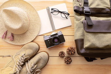 Top view of clothing and personal accessory on wooden background