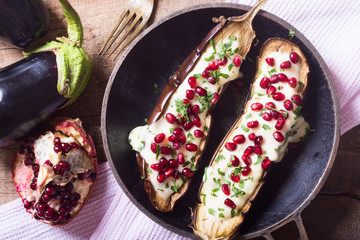eggplants with garlic yogurt sauce and pomegranate