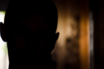Silhouette of bald woman