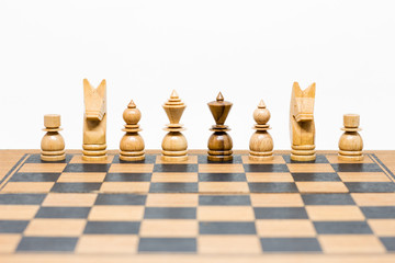 wooden chess board on white background