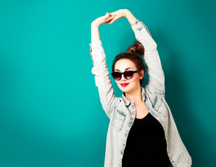 Happy Hipster Fashion Girl on Turquoise Background
