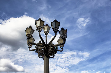 Fotomurales - Historical street lamp with blue sky background in Berlin