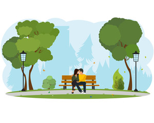 Young beautiful couple sitting in the park.