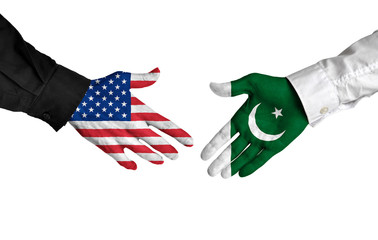 United States and Pakistan leaders shaking hands on a deal agreement