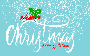 Red car carries Christmas spruce. Christmas is coming to town. Christmas Lettering.