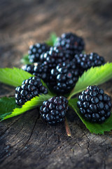 Blackberries on a wooden background