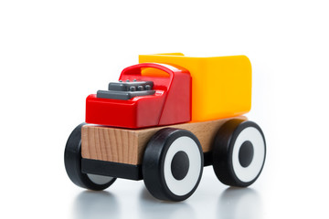 wooden toy race car on white background