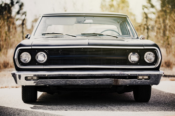 Front view of classic american black car.
