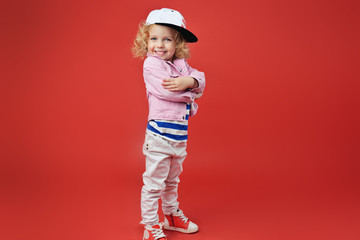 Portrait of a cute little girl in fashionable clothes. beautiful