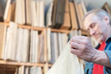 Closeup of an artist's hands crafting canvas. Selective focus