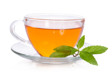 Glass cup of tea with mint on white