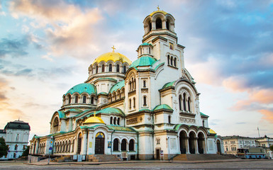 Foto auf Acrylglas Denkmal St. Alexander Nevsky Cathedral in the center of Sofia, capital of Bulgaria against the blue morning sky with colorful clouds