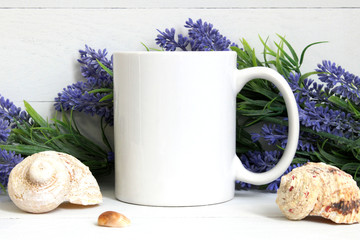 Mock-up of a white mug with lavender and seashells