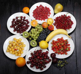 fruits and berries on wooden background