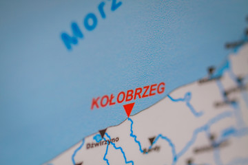 Kolobrzeg marked with a red arrow on the tourist information board.