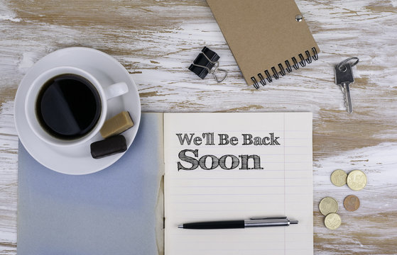 We'll Be Back Soon  - Copybook on the desktop