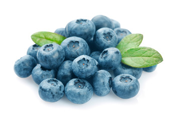 Heap of blueberries with leaves isolated on white background