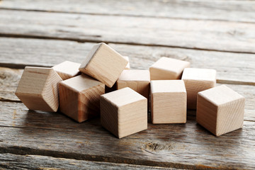 Wooden toy cubes on a grey wooden table