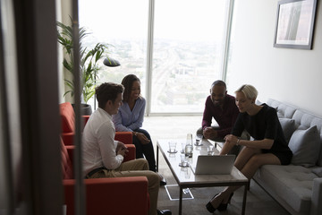 Businesspeople Have Informal Meeting In High Rise Office