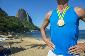 First place athlete wearing gold medal standing outdoors in front of Sugarloaf Mountain Rio de Janeiro Brazil