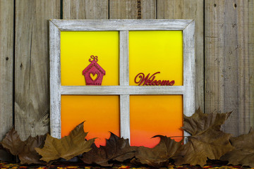 Welcome sign in window with leaves border