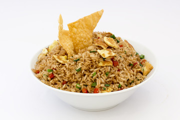 "Peruvian food, ""arroz chaufa"" fried rice with wantan over white background."
