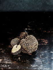 Background old metal surface with black truffles  with free text space. Selective focus