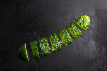 The cucumber slices falling in air