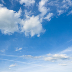 Beautiful cloudscape over horizon. White clouds and blue sky.