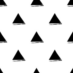Hand Drawn vector seamless pattern made with ink. Triangles shapes isolated. Textile design