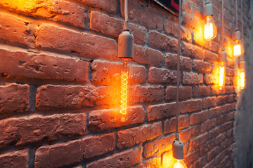 vintage electric bulbs. brick wall