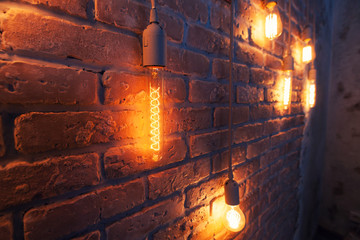vintage electric bulbs. brick wall