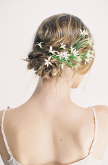 Young woman, hair up, flowers in hair, rear view