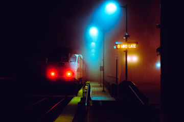 Train in station at night