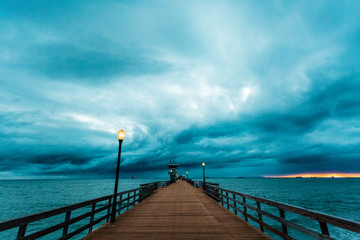 Stormy sky above pier at dusk