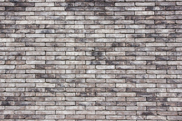 Grunge gray brick wall background.