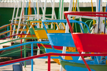 Empty Playground and swings in colorful park, Russia.