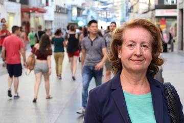 Mature Woman in European Rush Hour Crowded Street