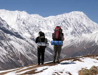 Two trekkers and mount Tilicho