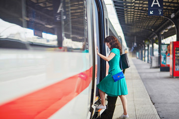 Young woman on the platform of a train station