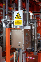 The radiation icon . Radiation symbol . radiation tag. radiation caution on multi phase flow meter on oil and gas platform.flow transmitter.