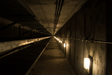 Underground tunnel with metallic pipes