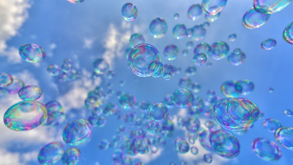 Vibrantly colored soap bubbles against a clean blue sky.